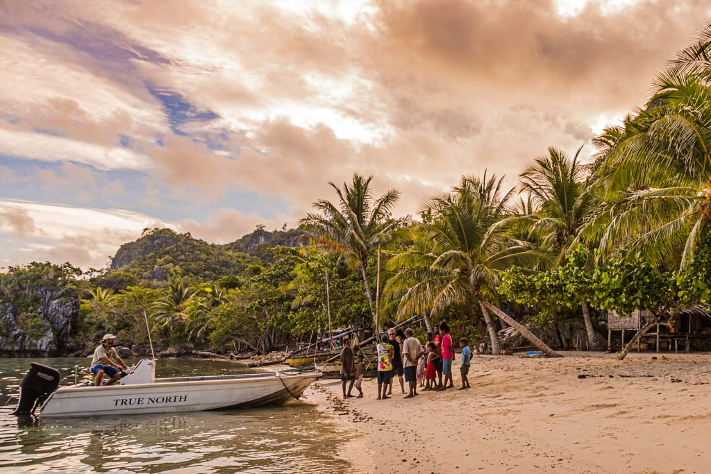 PNG Tribes  and True North Guide at Panasia Beach